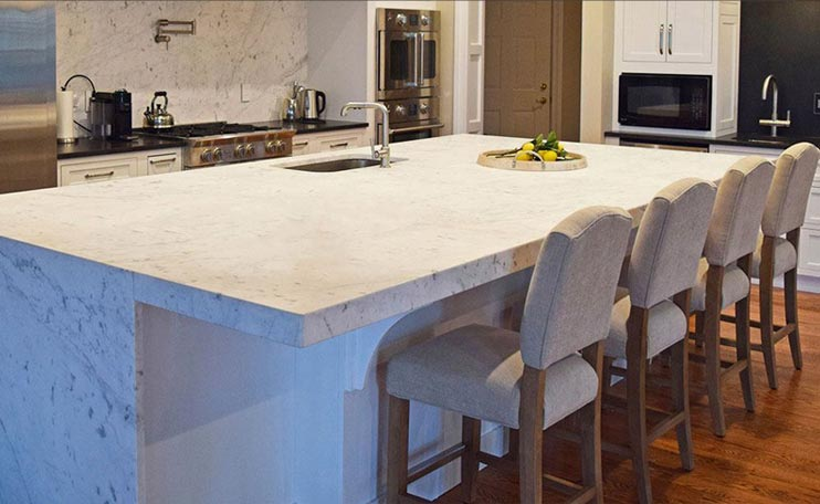 kitchen island with stone counter and stone sides